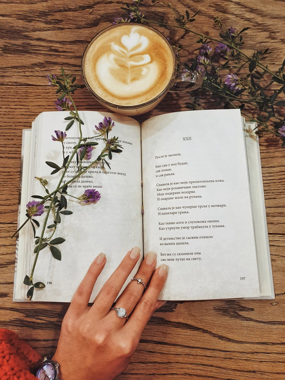 beverage in cup next to open book