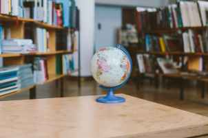 photo of globe on wooden table