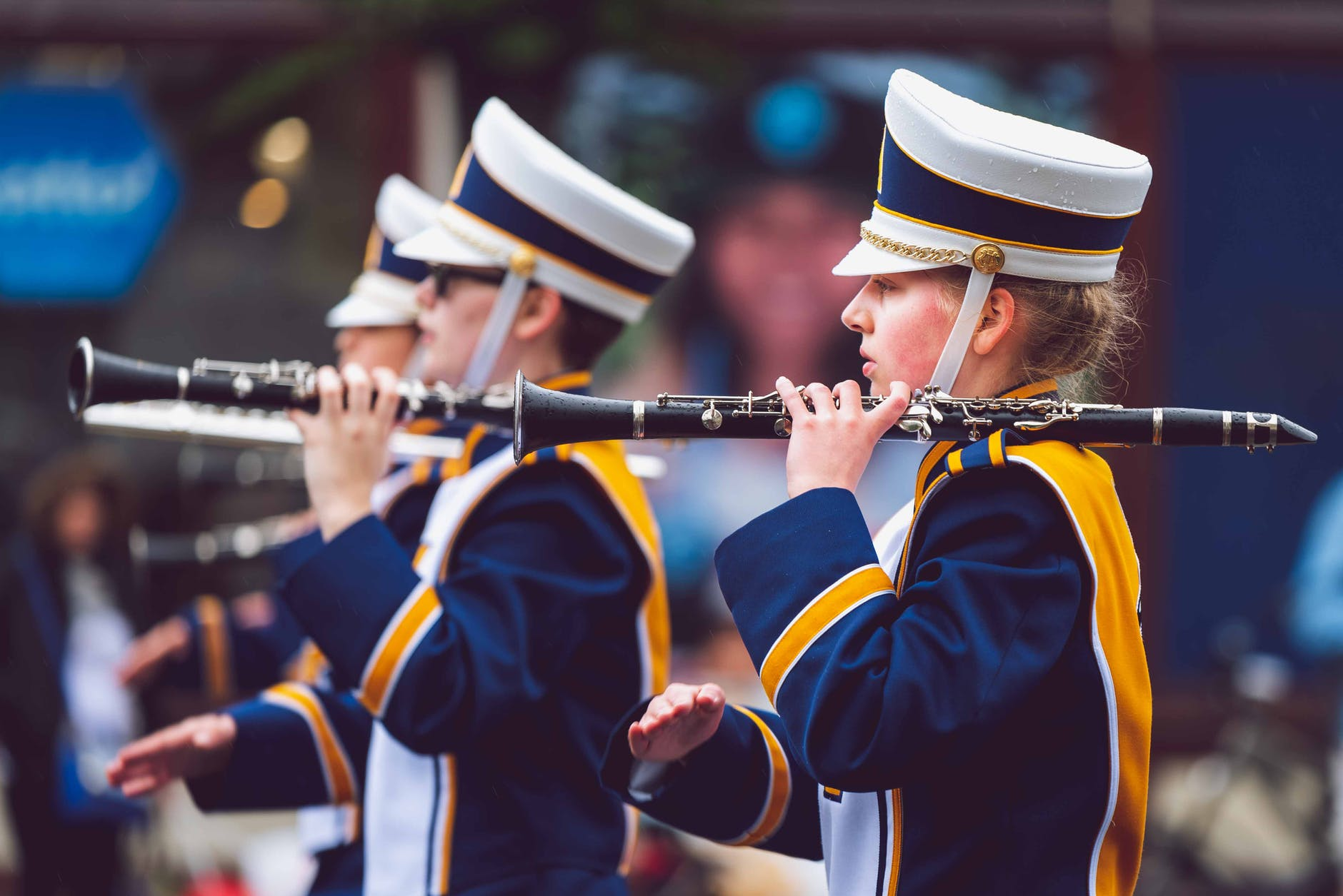 selective focus photography of people holding clarinets